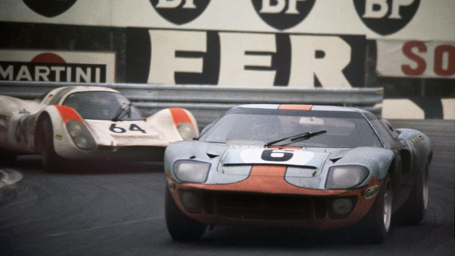 Jackiy Ixkz and Jackie Oliver winning the 1969 Le Mans in a GT 40