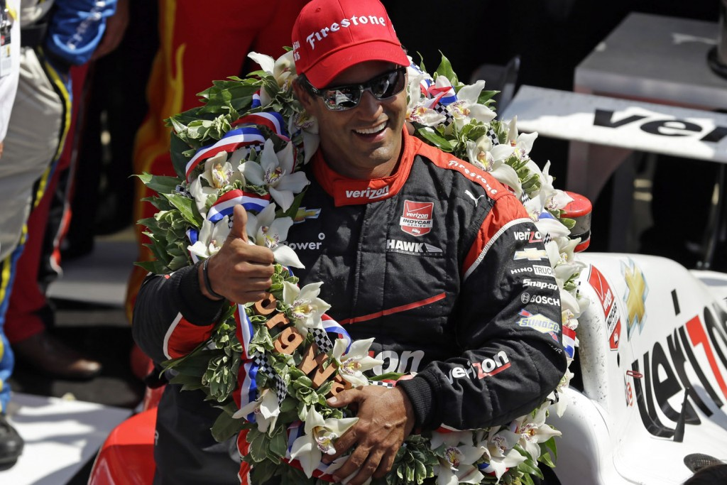 Juan Pablo Montoya, of Colombia, celebrates after winning the 99th running of the Indianapolis 500 auto race at Indianapolis Motor Speedway in Indianapolis, Sunday, May 24, 2015.  (AP Photo/Michael Conroy)