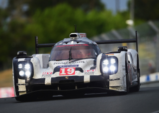 Porsche Team driven by Nico Hulkenberg, Earl Bamber and Nick Tandy during the Le Mans 24 Hour race at the Circuit de la Sarthe on June 14, 2015 in Le Mans, France.  (Photo by Shaun Botterill/Getty Images)
