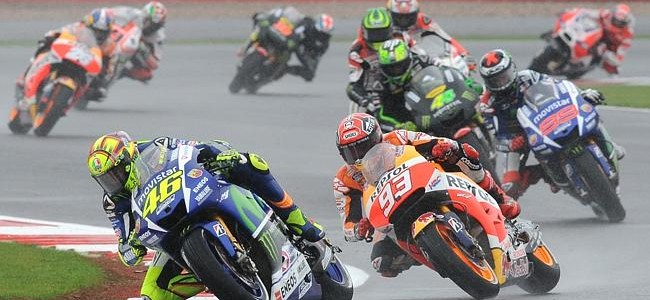 Valentino Rossi wins British GP on rain-drenched track to move top of MotoGP standings