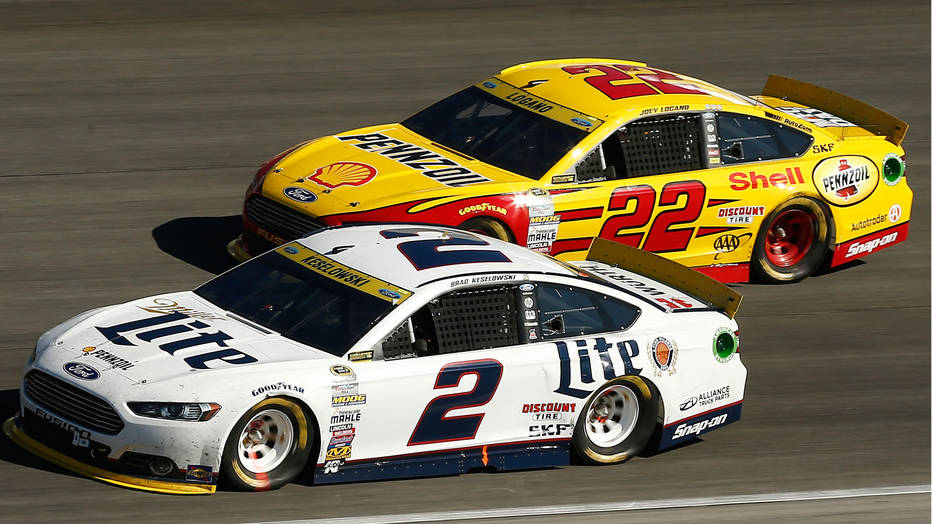 Brad Keselowski and Joey Logano battling for a place