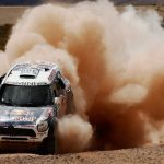 Al-Attiyah splashes and slides his way to big lead