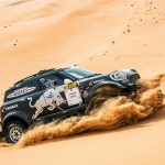 Husband and wife team Stephane and Andrea Peterhansel victorious at Abu Dhabi Desert Challenge