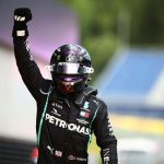 Lewis Hamilton gives black power salute on the podium after winning the Styrian Grand Prix
