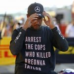 FIA INVESTIGATING LEWIS HAMILTON FOR 'ARREST THE COPS' T-SHIRT